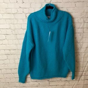 Mixed stitch roll neck sweater